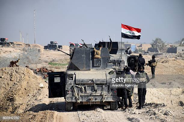 Iraqi forces stand guard at the south of Ramadi in Anbar Iraq during the second day of the anti DAESH operation on December 23 2015