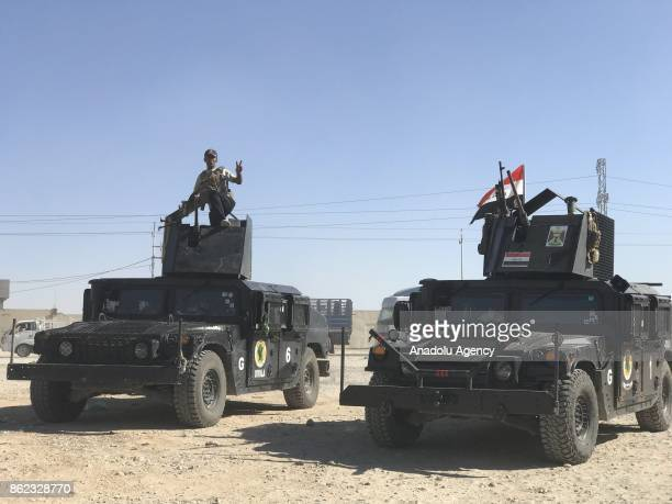 Iraqi forces take security measurements at the controls points as vehicles on their way back to Kirkuk after Iraqi forces retake the control of the...