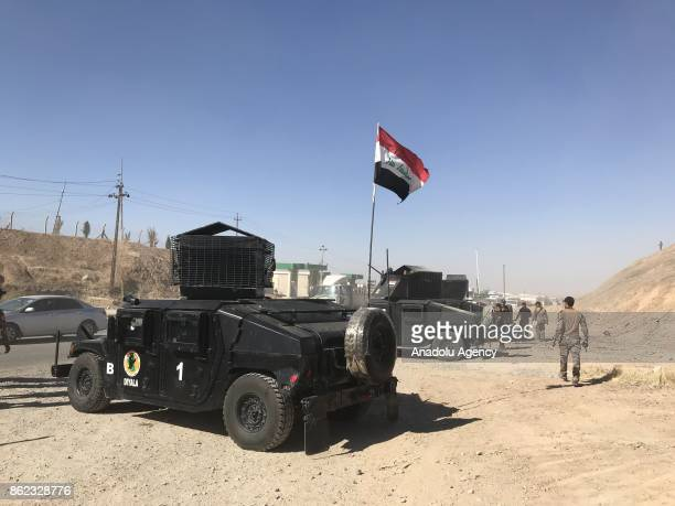 Iraqi forces take security measurements at the controls points as vehicles are seen on their way back to Kirkuk after Iraqi forces retake the control...