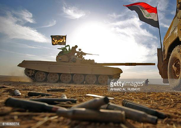 TOPSHOT Iraqi forces units hold a position near the village of Tall alTibah some 30 kilometres south of Mosul during an operation to retake the main...