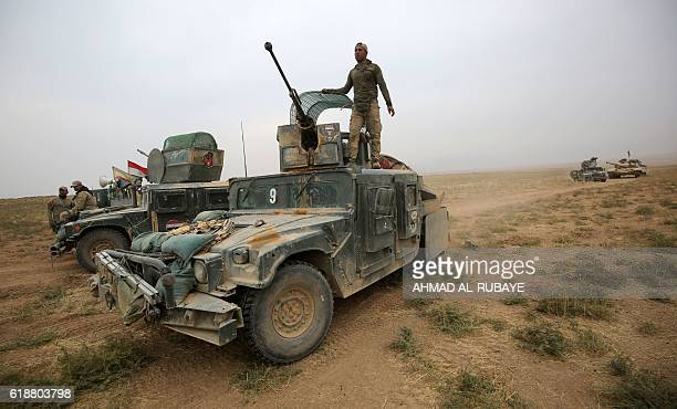 Iraqi forces wait on their armoured vehicles in the alShura area south of Mosul on October 28 2016 during an operation to retake the main hub city...