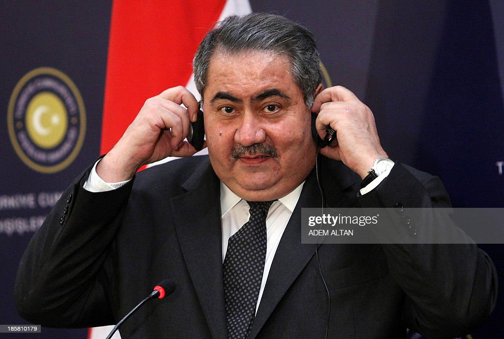 Iraqi Foreign Minister Hoshyar Zebari adjusts his headphones during a press conference with his Turkish counterpart following their talks in Ankara on October 25, 2013.