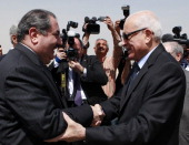 Iraqi Foreign Minister Hoshyar Zebari left and Arab League Secretary General Nabil Elaraby right shake hands March 25 2012 in Baghdad Iraq Elaraby...