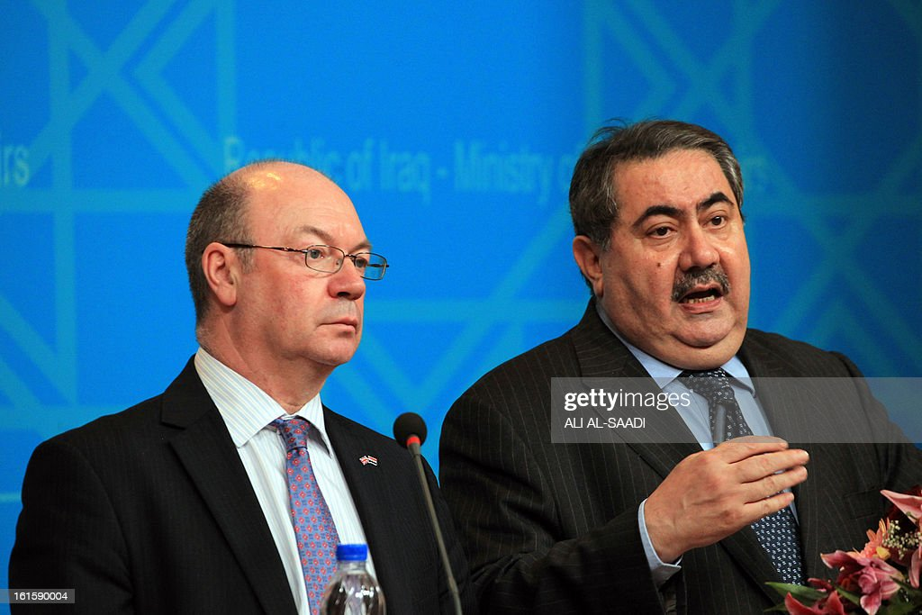 Iraqi Foreign Minister Hoshyar Zebari (R) speaks during a joint press conference with British Foreign Office Minister for the Middle East Alistair Burt , at the Ministry headquarters in Baghdad on February 12, 2013.