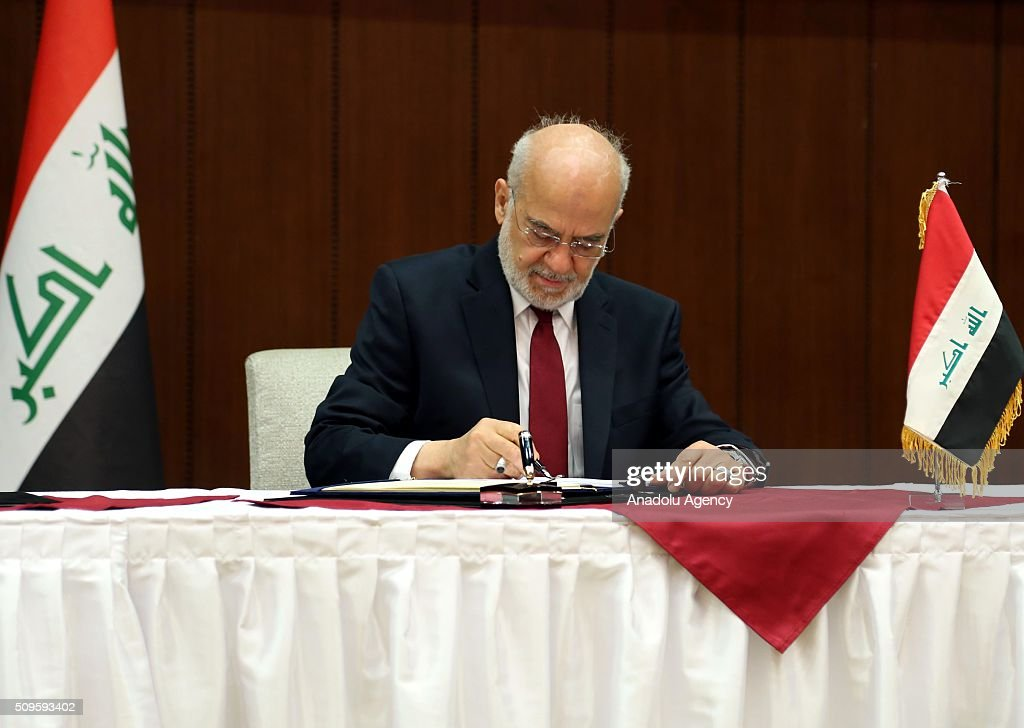 Iraqi Foreign Minister Ibrahim al-Jaafari signs protocols on cooperation with Russian Deputy Prime Minister Dmitry Rogozin (not seen) at the Foreign Ministry in Baghdad, Iraq on February 11, 2016.