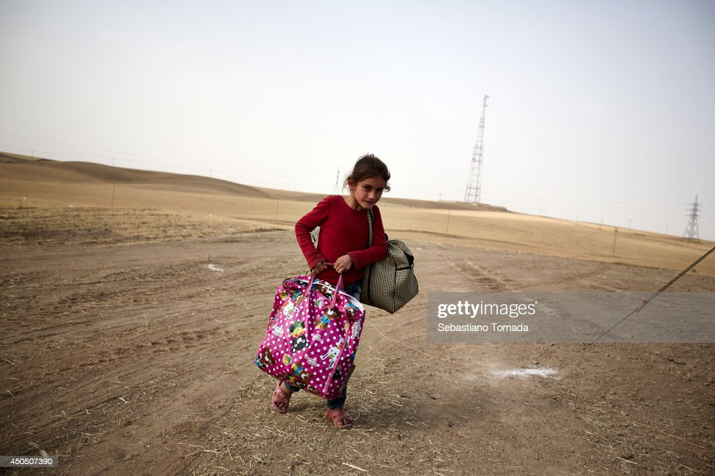 A Iraqi girl fleeing from the city of Mosul arrives at a Kuridish checkpoint. ISIS has captured major roads and town in central Iraq. June 12, 2014.
