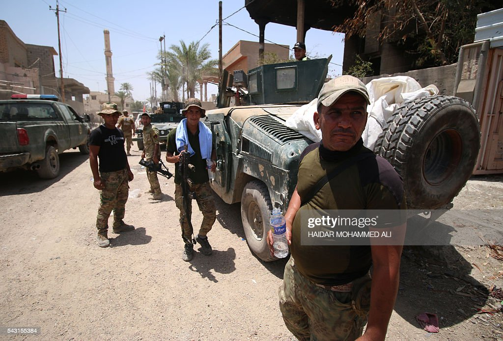 Iraqi government forces are seen in Fallujah, 50 kilometres (30 miles) from the capital Baghdad, after they retook the embattled city from the Islamic State group on June 26, 2016. Iraqi Prime Minister Haider al-Abadi urged all Iraqis to celebrate the recapture of Fallujah by the security forces and vowed the national flag would be raised in Mosul soon. While the battle has been won, Iraq still faces a major humanitarian crisis in its aftermath, with tens of thousands of people who fled the fighting desperately in need of assistance in the searing summer heat. ALI