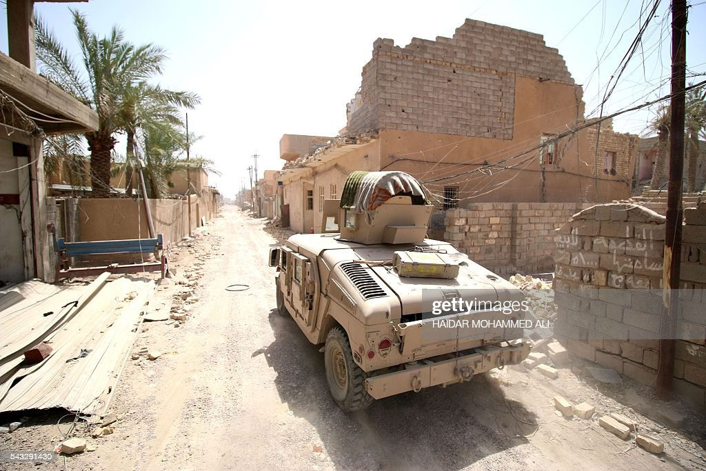 Iraqi government forces drive their armoured vehicle as they patrol a street in western Fallujah, 50 kilometres (30 miles) from the Iraqi capital Baghdad, after Iraqi forces retook the embattled city from the Islamic State group on June 27, 2016. Iraqi forces took the Islamic State group's last positions in the city of Fallujah on June 26, 2016, establishing full control over one of the jihadists' most emblematic bastions after a month-long operation. ALI