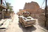 Iraqi government forces drive their armoured vehicle as they patrol a street in western Fallujah 50 kilometres from the Iraqi capital Baghdad after...