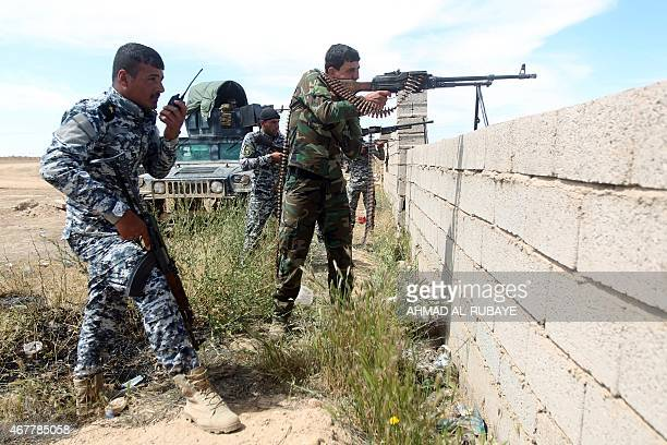 Iraqi government forces hold a position on the western outskirts of Tikrit on March 27 during a military operation to retake the city from Islamic...