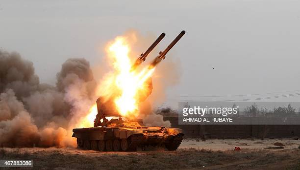 Iraqi government forces launch rockets towards Islamic state group's fighters holed up in the centre of the city of Tikrit on March 28 2015 during a...