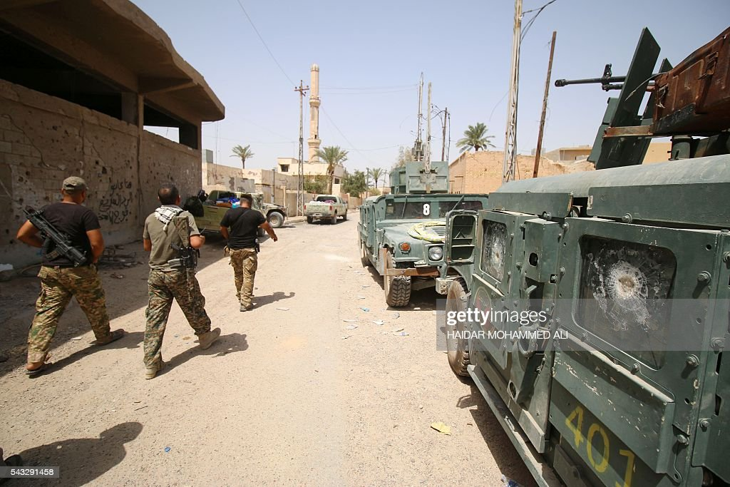 Iraqi government forces patrol a street in western Fallujah, 50 kilometres (30 miles) from the Iraqi capital Baghdad, after Iraqi forces retook the embattled city from the Islamic State group on June 27, 2016. Iraqi forces took the Islamic State group's last positions in the city of Fallujah on June 26, 2016, establishing full control over one of the jihadists' most emblematic bastions after a month-long operation. ALI