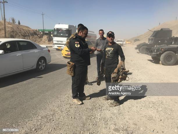 Iraqi government forces take security measures at a control point as families fled to Erbil and Sulaymaniyah after Iraqi forces take the control of...