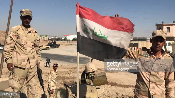 Iraqi government forces take security measures at a control points after Iraqi forces take the control of the city center from Peshmerga forces in...