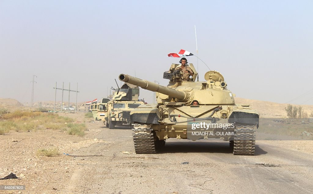 Iraqi government forces vehicles are seen near the Falahat village west of Fallujah on June 27, 2016. Iraqi forces took the Islamic State group's last positions in the city of Fallujah on June 26, establishing full control over one of the jihadists' most emblematic bastions after a month-long operation. / AFP / MOADH