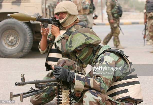 Iraqi Interior Ministry commandos take up position on April 19 2008 in the district of Hayaniyah north of Basra 370 miles south of Baghdad Iraq Iraqi...