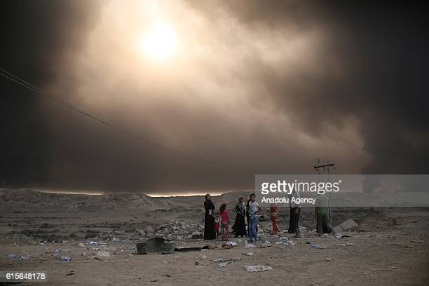 Iraqi internally displaced civilians are seen as they have arrived at Al Qayyarah town secured by Iraqi Army in Mosul on October 19 2016 after they...
