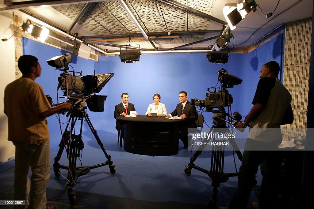Iraqi Journalists Qayess al-Hayyali, Zaynab Karam and Amer al-Samaraie of Al-Sumariya, a new Iraqi satellite television channel broadcasting from Beirut for security reasons, present a test news bulletin at a studio in Beirut, 18 October 2004. The news bulletin, headed by Lebanese journalist May Kahhaleh, is due to start after the end of Ramadan in mid-November. Al-Sumariya's chairman is Lebanese Jean Claude Boulos, one of the founders of the state channel Tele-Liban - the Arab world's first television station, founded in 1958. AFP PHOTO/Joseph BARRAK
