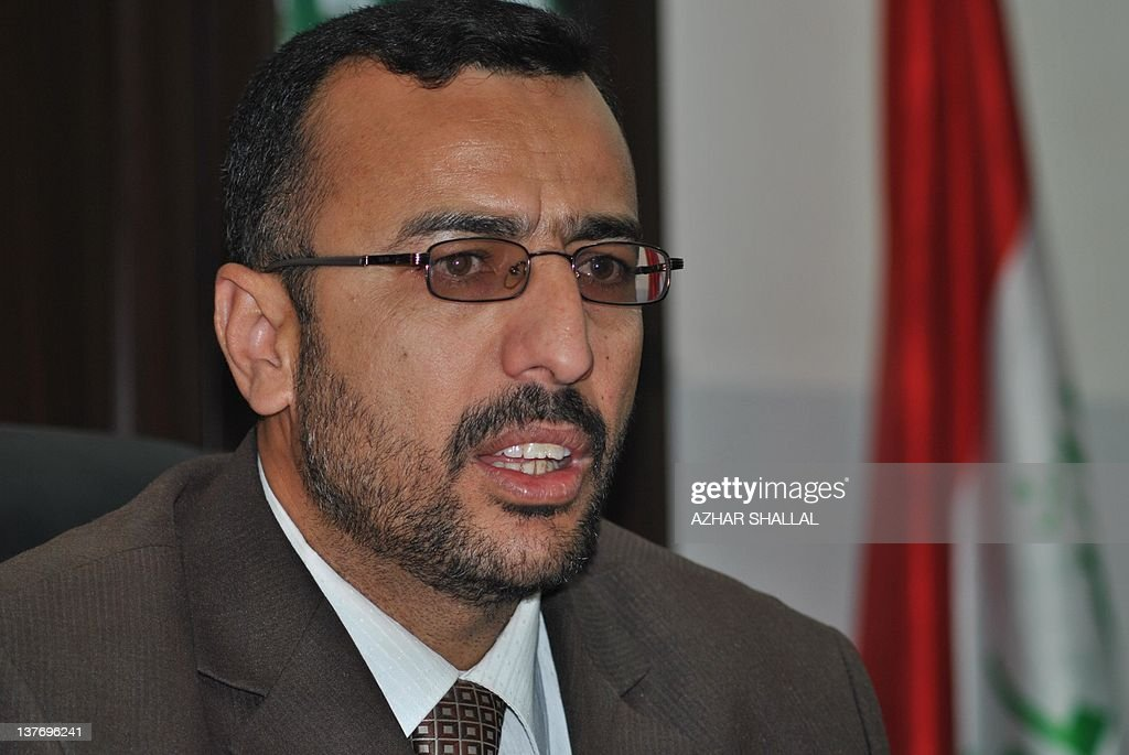 Iraqi Khalid Salman, a Haditha city councillor and lawyer, talks about the 2005 fatal shooting of 24 Iraqi civilians by US troops in the predominantly Sunni Anbar province in western Iraq during an interview on January 24, 2012 at his office in the town of around 80,000 people where the killings took place. Salman who is lawyer for the victims, vowed to continue pursuing the case of those killed by US troops in 2005 who have voiced shock and disgust over the light sentence meted out to a US soldier involved in the massacre. AFP PHOTO/AZHAR SHALLAL