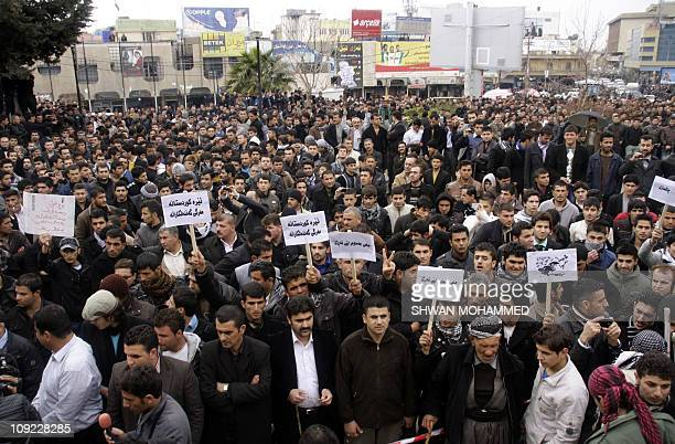 Iraqi Kurdish antigovernment protesters march in the city of Sulaimaniyah on February 17 2011 before two demonstrators were killed when security...
