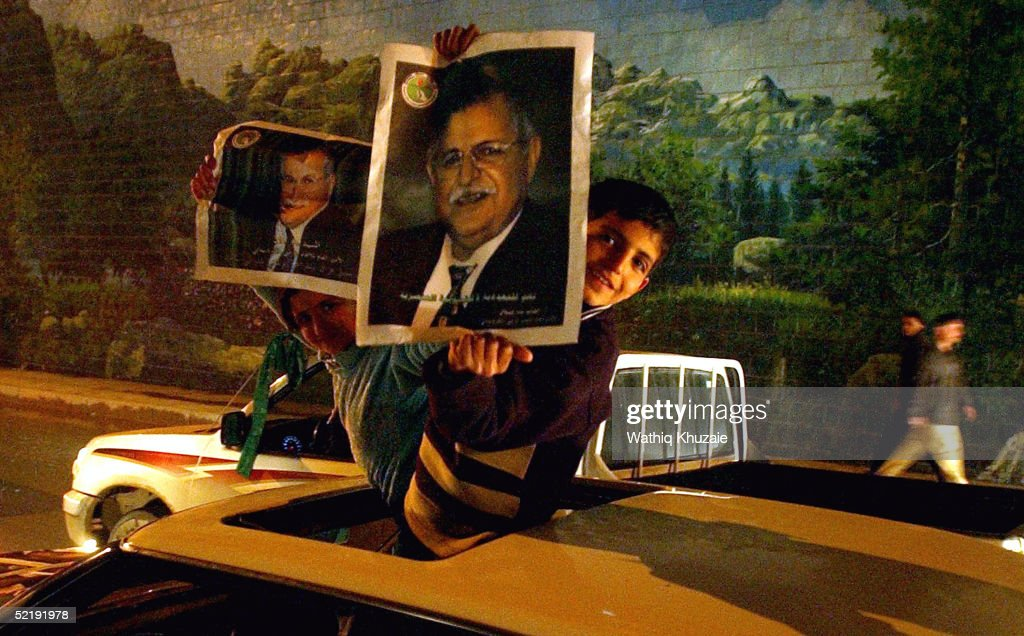 Iraqi Kurdish children hold up pictures of the Kurdish leader Jalal Talabani as they celebrate the results of general elections February 13 2005 in...