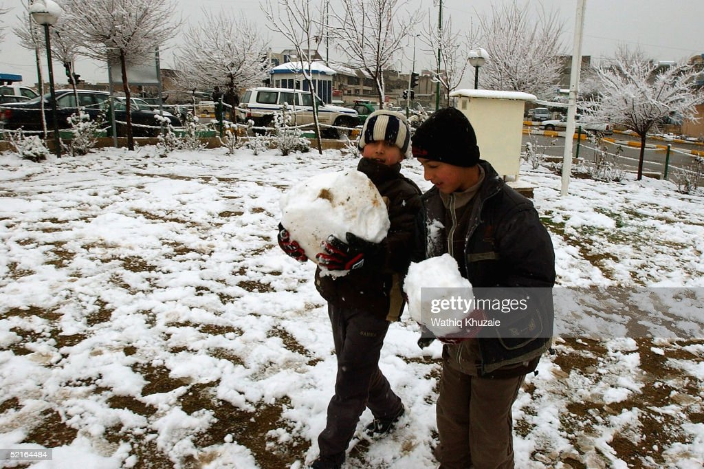Iraqi Kurdish children play in the snow February 9 2005 in the northern Iraqi city of Suleimaniya Iraq The announcement of the final results of Iraqs...