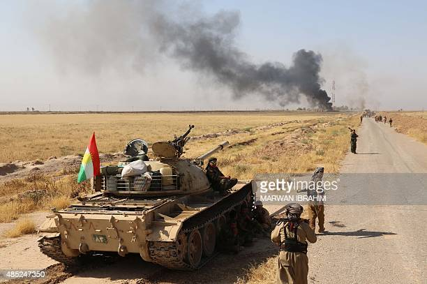 Iraqi Kurdish fighters keep position in an area between the districts of Daquq and Tuz some 55 kms south of the Kurdishcontrolled city of Kirkuk...