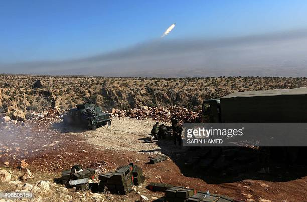 Iraqi Kurdish forces take part in an operation backed by USled strikes in the northern Iraqi town of Sinjar on November 12 to retake the town from...