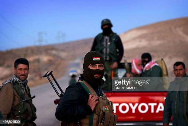Iraqi Kurdish forces take part in an operation backed by USled strikes on the outskirts of northern Iraqi town of Sinjar on November 12 to retake the...