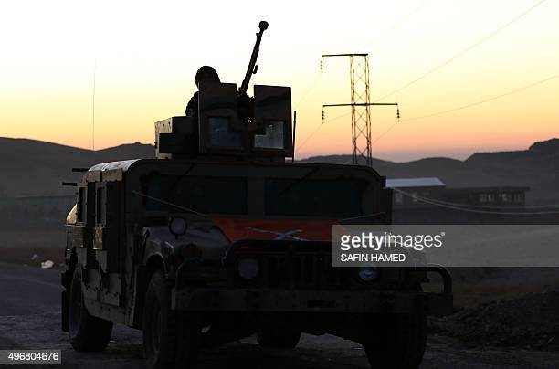 Iraqi Kurdish forces take part in an operation backed by USled strikes on the outskirts of the northern Iraqi town of Sinjar on November 12 to retake...