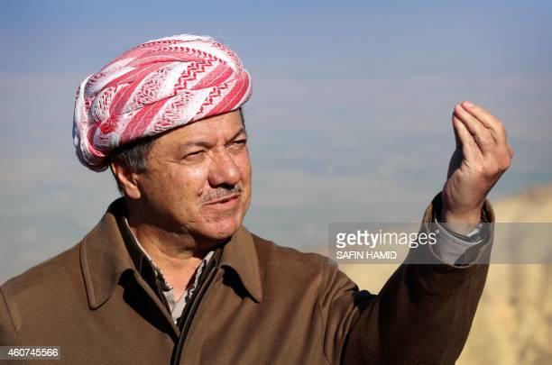Iraqi Kurdish leader Masoud Barzani speaks to journalists on December 21 2014 during a visit to Mount Sinjar west of the northern Iraqi city of Mosul...