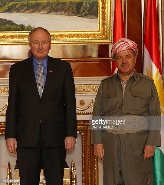 Iraqi Kurdish leader Massud Barzani poses next to Canada's Minister of Foreign Affairs Rob Nicholson during a meeting on March 5 2015 in Arbil the...