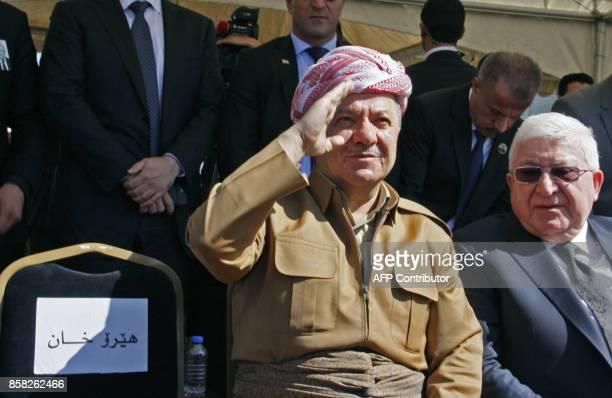 Iraqi Kurdish leader Massud Barzani sits next to Iraqi President Fuad Massum during a ceremony at the airport in the Iraqi Kurdish city of...