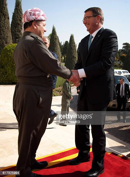 Iraqi Kurdish leader Massud Barzani welcomes US Secretary of Defence Ashton Carter ahead of a meeting on October 23 2016 in Arbil the capital of the...