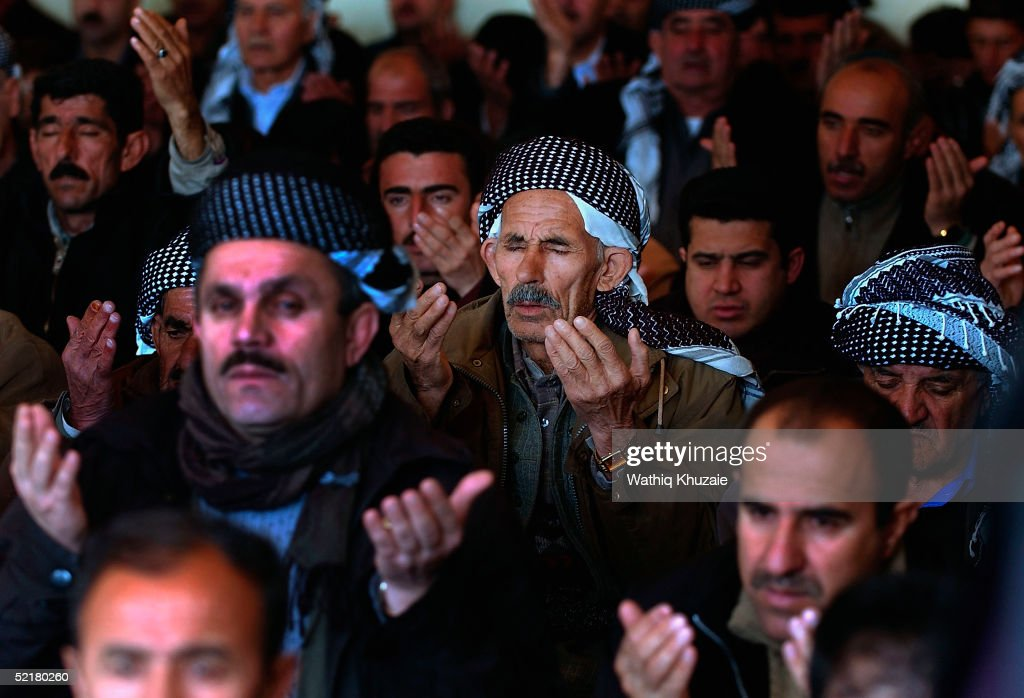 Iraqi Kurdish men are seen praying during a Friday prayer service at the Gaoura mosque on February 11 2005 in the northern Iraqi city of Suleimaniya...