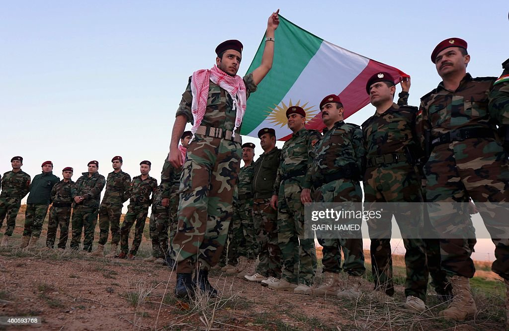 Iraqi Kurdish Peshmerga fighters celebrate flag day in the northern city of Arbil the capital of the autonomous Kurdish region in northern Iraq on...