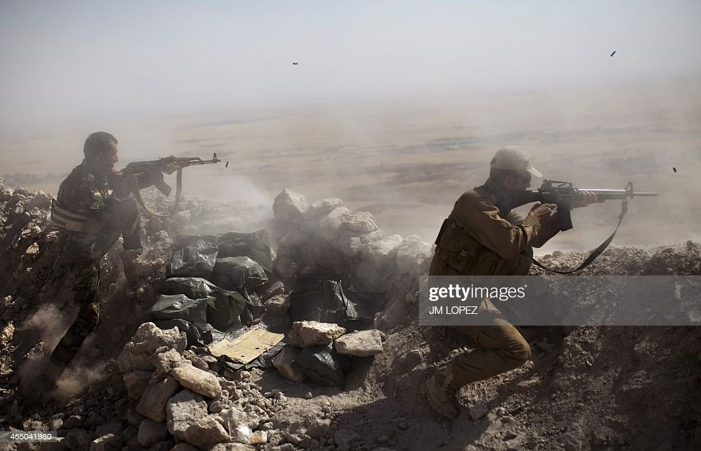 Iraqi Kurdish Peshmerga fighters fire at IslamicState militant positions from their position on the top of Mount Zardak a strategic point taken 3...