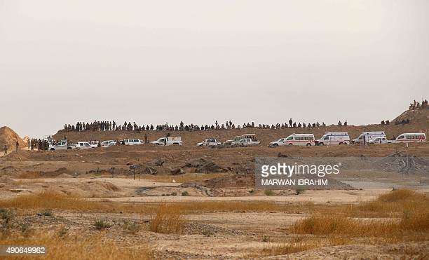 Iraqi Kurdish Peshmerga fighters gather at a location after they reportedly captured several villages from Islamic State group jihadistst on the...