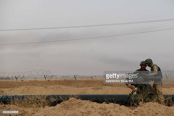 Iraqi Kurdish Peshmerga fighters watch for jihadists after they reportedly captured several villages from Islamic State group jihadistst on the...