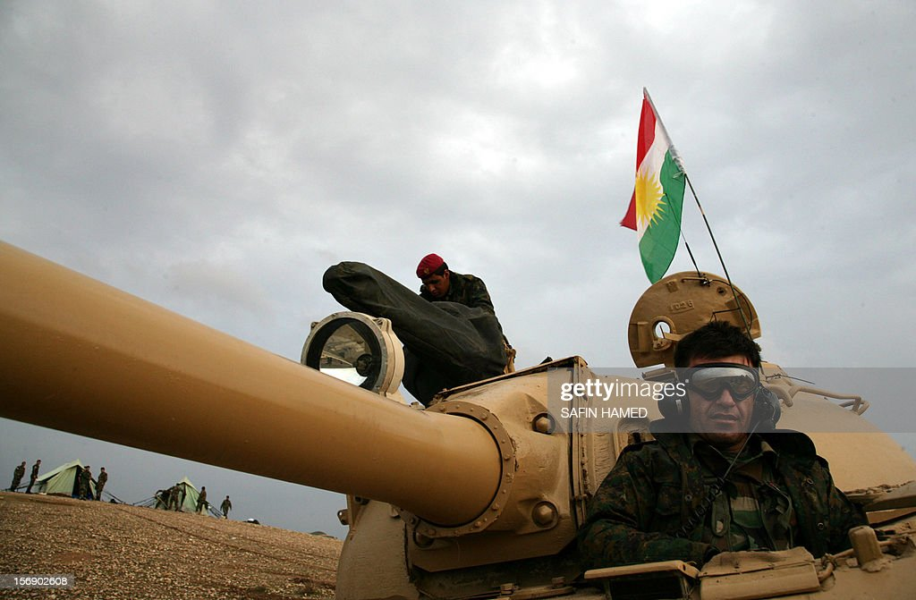 Iraqi Kurdish peshmerga forces are seen in a tank, flying the Kurdish flag, stationed 20 kilometres north of Kirkuk on November 24, 2012. Iraq's parliament speaker Osama al-Nujaifi said that 'significant progress' has been made on resolving an Arab-Kurd crisis, although a deployment of Kurdish forces in the country's north has raised the stakes. AFP PHOTO / SAFIN HAMED