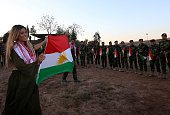 Iraqi Kurdish pop singer Dashni Murad known as the Shakira of Kurdistan carries a Kurdistan flag during a visit to Kurdish Peshmerga fighters...