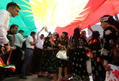 Iraqi Kurdish protesters deploy a giant flag of their autonomous Kurdistan region during a demonstration to claim for its independence on July 3 2014...