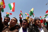 Iraqi Kurdish protesters wave flags of their autonomous Kurdistan region during a demonstration to claim for its independence on July 3 2014 outside...