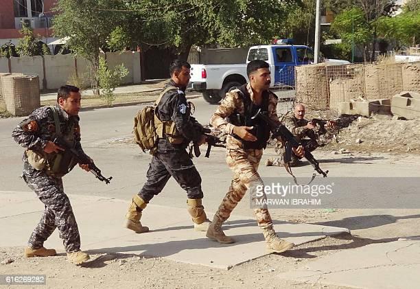 TOPSHOT Iraqi Kurdish security forces patrol a street in the southern suburbs of Kirkuk on October 22 after jihadist gunmen attacked the city...