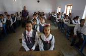 Iraqi Kurdish students sit at a classroom on the first day of the new school year in Arbil 320 kms north of Baghdad late on September 12 2010 AFP...