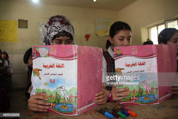 DUNLOP Iraqi Kurdish students sit at the Jawhery School during an Arabic language course on May 6 2014 in Sulaimaniyah AFP PHOTO / SHWAN MOHAMMED