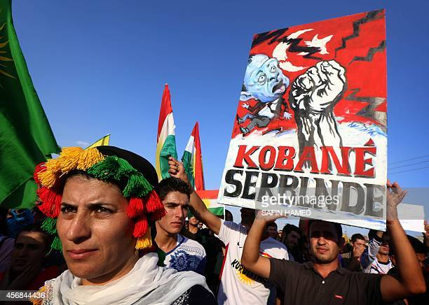 Iraqi Kurdish supporters of the Kurdistan Workers Party demonstrate against the threat imposed by the Islamic State group jihadists against the...