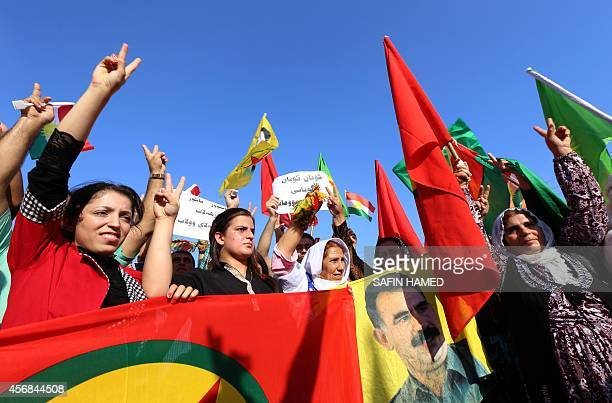 Iraqi Kurdish supporters of the Kurdistan Workers Party hold a banner with a portrait of PKK leader Abdullah Ocalan during a demonstration against...