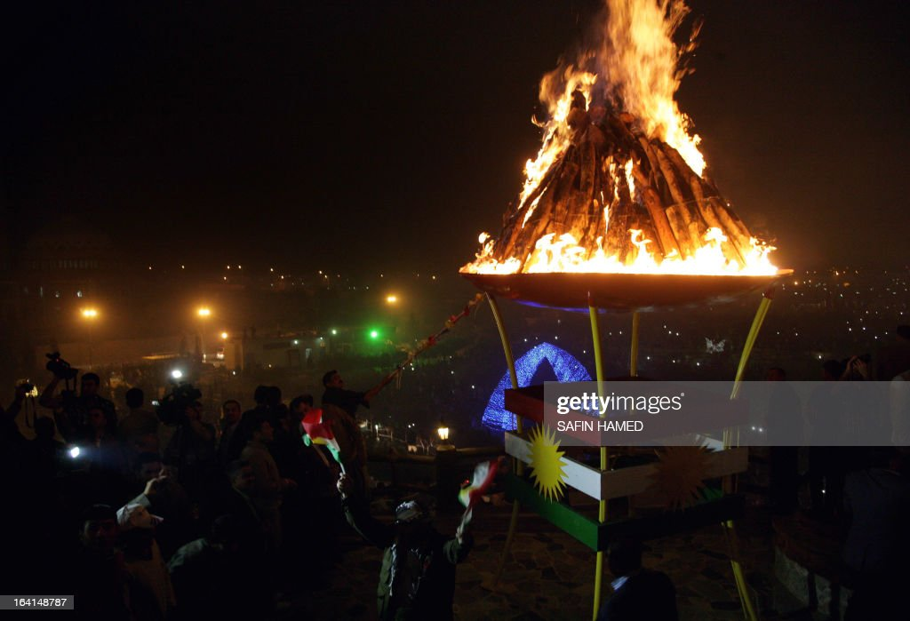 Iraqi Kurds ignite a bonfire to celebrate new year which marks the beginning of the Noruz spring festival in the northern city of Arbil, the capital of the autonomous Kurdistan region, on March 20, 2013. The Persian New Year is an ancient Zoroastrian tradition celebrated by Iranians and Kurds which coincides with the vernal (spring) equinox and is calculated by the solar calender.