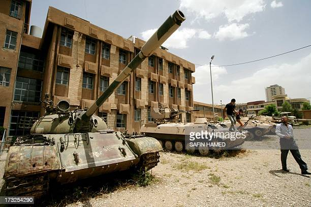 DECAMME Iraqi Kurds look at tanks as they visit a former torture centre that was turned into a museum named 'National Museum In Order Not To Forget'...